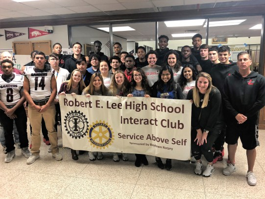 Lee High School's Interact Club poses with the Lee College Athletics Department