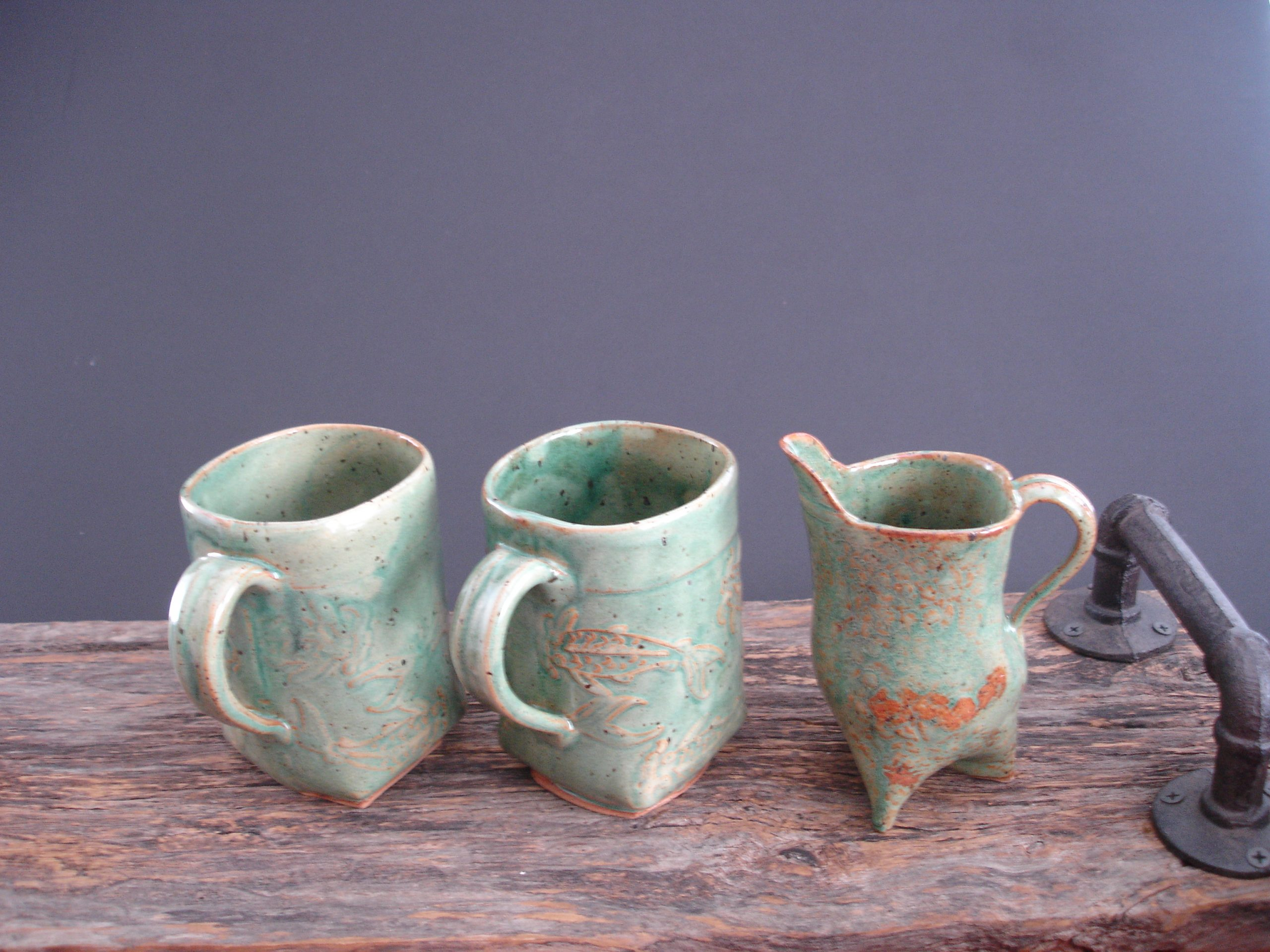 hand built pottery mugs and creamer