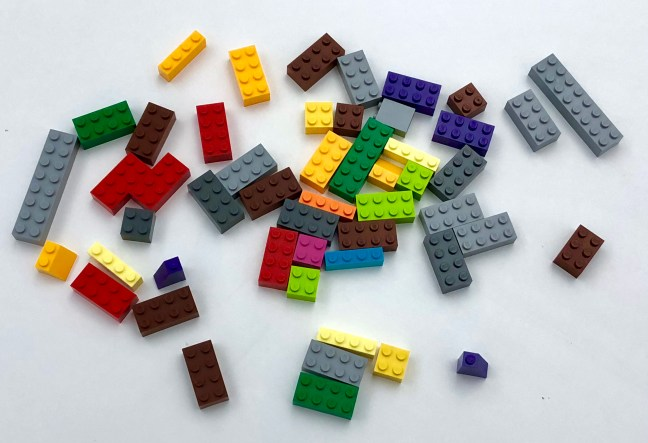 LEGO bricks spread all over a table in no order