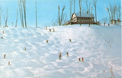 Skiers navigate the moguls at Sugar Loaf ski resort in happier, and more solvent, days. (Flickr photo by Don Harrison)