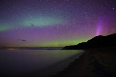 Night sky and northern lights from Esch Beach by Dale Niesen