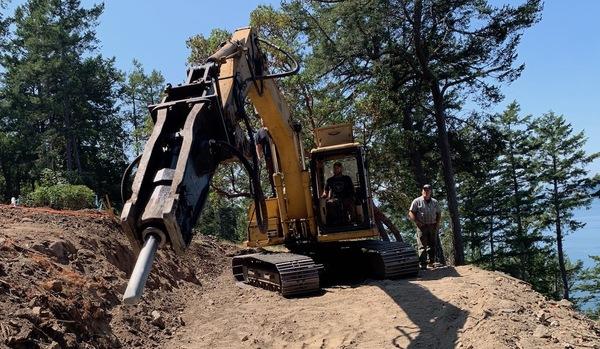 excavator comes back