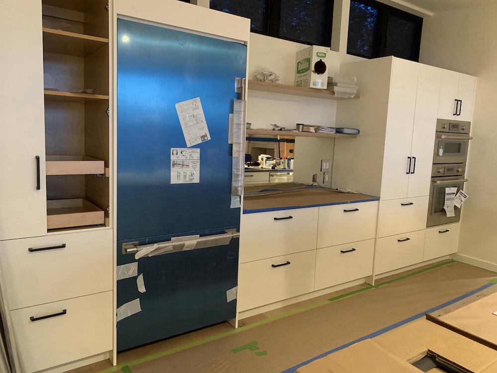 kitchen with blue refrigerator