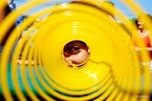 girl peering through slinky