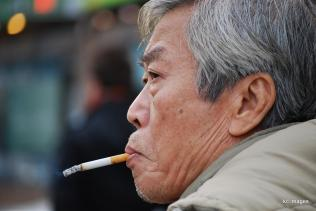 man with cigarette hanging from his mouth