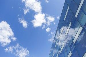 Image of blue sky reflecting on windows.