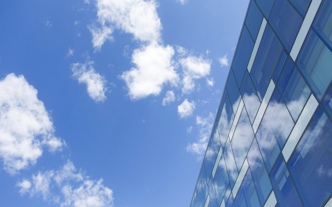 Image of blue sky reflecting on windows.