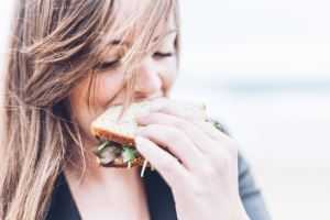 science nutrition woman eating sandwich