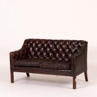 England, circa 1940 small tufted sofa