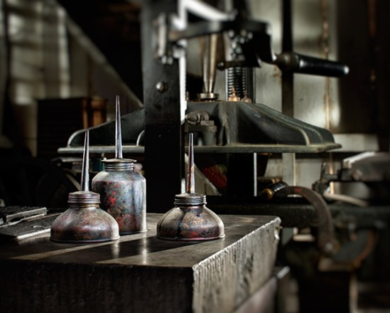 Oil cans and printing press