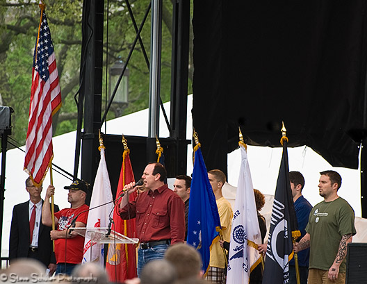 Greg Graffin (lead singer of punk band Bad Religion) sings the National Anthem acapella in front of atheist members of all branches of the military to officially kick off the day