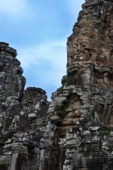 Faces look down from the walls of Bayon.
