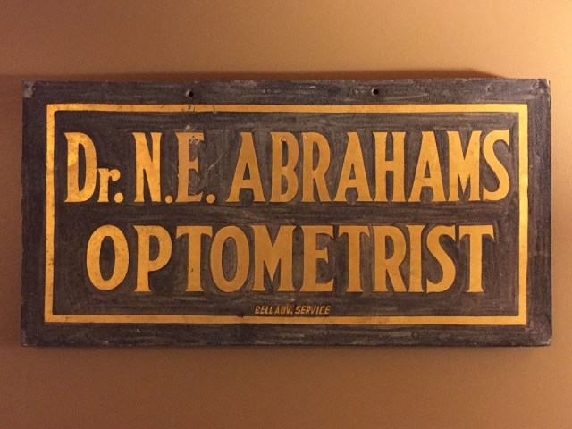 N.E. Abrahams Optometrist Sign