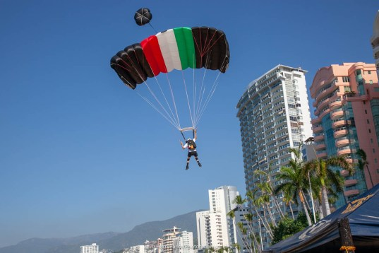 Super Johnny Saavedra co-organizer and local enjoying the legal jumps and beach landings. - Team ILL Vision hosts the Acapulco BASE Boogie off the La Palapa hotel - Promoting tourism through Low Altitude Parachute Deployment Demonstration Jumping - Harry Parker Photography - Reflecting the best of your business, product, self.
