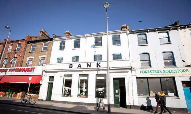 The rebel bank, printing its own notes and buying back people's debts || The Guardian