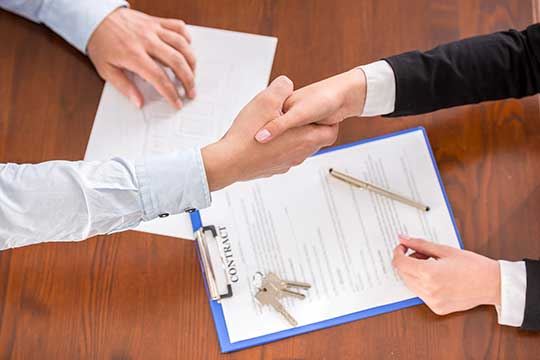 Residential Lease Agreement Form   Free Rental Agreement   Legal     a landlord and tenant shake hands after signing a lease agreement
