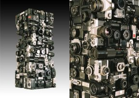 Rémy Tassou / Olympus is a Cybertrash totem made of cameras (98x38x38cm - 81kg)