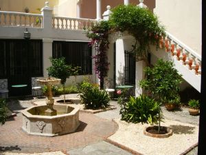 Legation courtyard: four orange trees in parterres of crushed seashells