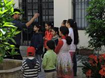 Ayoub Artista leads an activity with the children in the courtyard