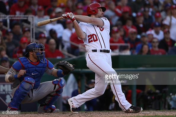 WASHINGTON, DC - OCTOBER 9: Daniel Murphy #20 of the Washington Nationals hits an RBI single in the seventh inning against the Los Angeles Dodgers during game two of the National League Division Series at Nationals Park on October 9, 2016 in Washington, DC. (Photo by Patrick Smith/Getty Images)