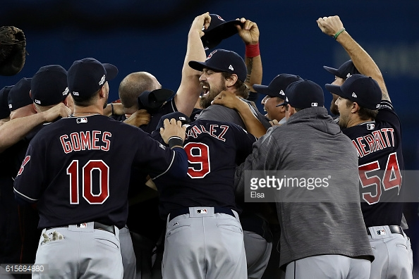 TORONTO, ON - OCTOBER 19: The Cleveland Indians celebrate after defeating the Toronto Blue Jays with a score of 3 to 0 in game five of the American League Championship Series at Rogers Centre on October 19, 2016 in Toronto, Canada. (Photo by Elsa/Getty Images).