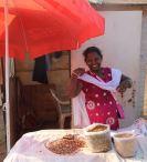 Selling peanuts, India
