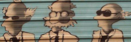 Représentation de médécins-professeurs, peinte sur la clôture érigée devant l'Hôpital de Château-Gontier. Clôture qui n'existe plus à présent...