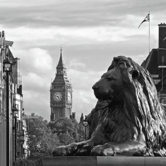 trafalgar-square-lion-with-big-ben-in-black-and-white-gill-billington
