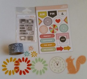 Transparent die cuts, floral washi tape, stamp set, and chip board shapes.