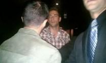 Zachary Levi (Chuck Bartowski) heading out of the men's room