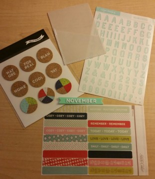 Clockwise from top left: Cork circle stickers, vellum pocket, vellum alphas, rubber month banner, washi strips