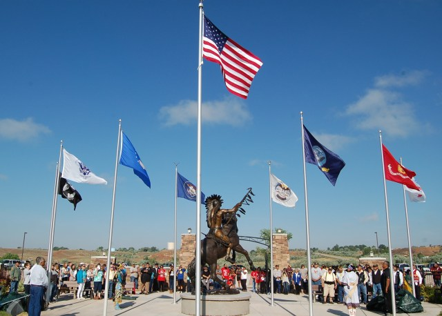 """A crowd gathers to take part in the unveiling of Lehi native and artist Jerime Hooley's 13-foot bronze statue """"Ute Warrior Chief"""" during a ceremony held July 2, 2016. Photo courtesy of MaKay Hooley"""