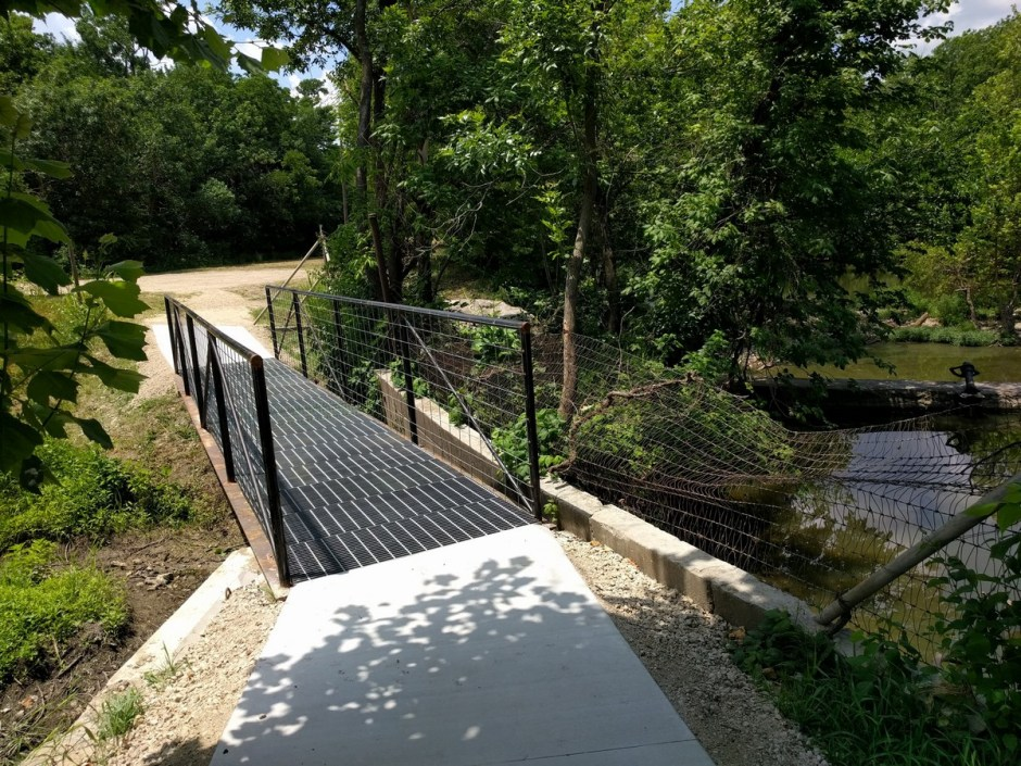 This bridge was constructed by volunteers, using reclaimed steel railroad rails, catwalk decking, steel pipes, and steel fencing.