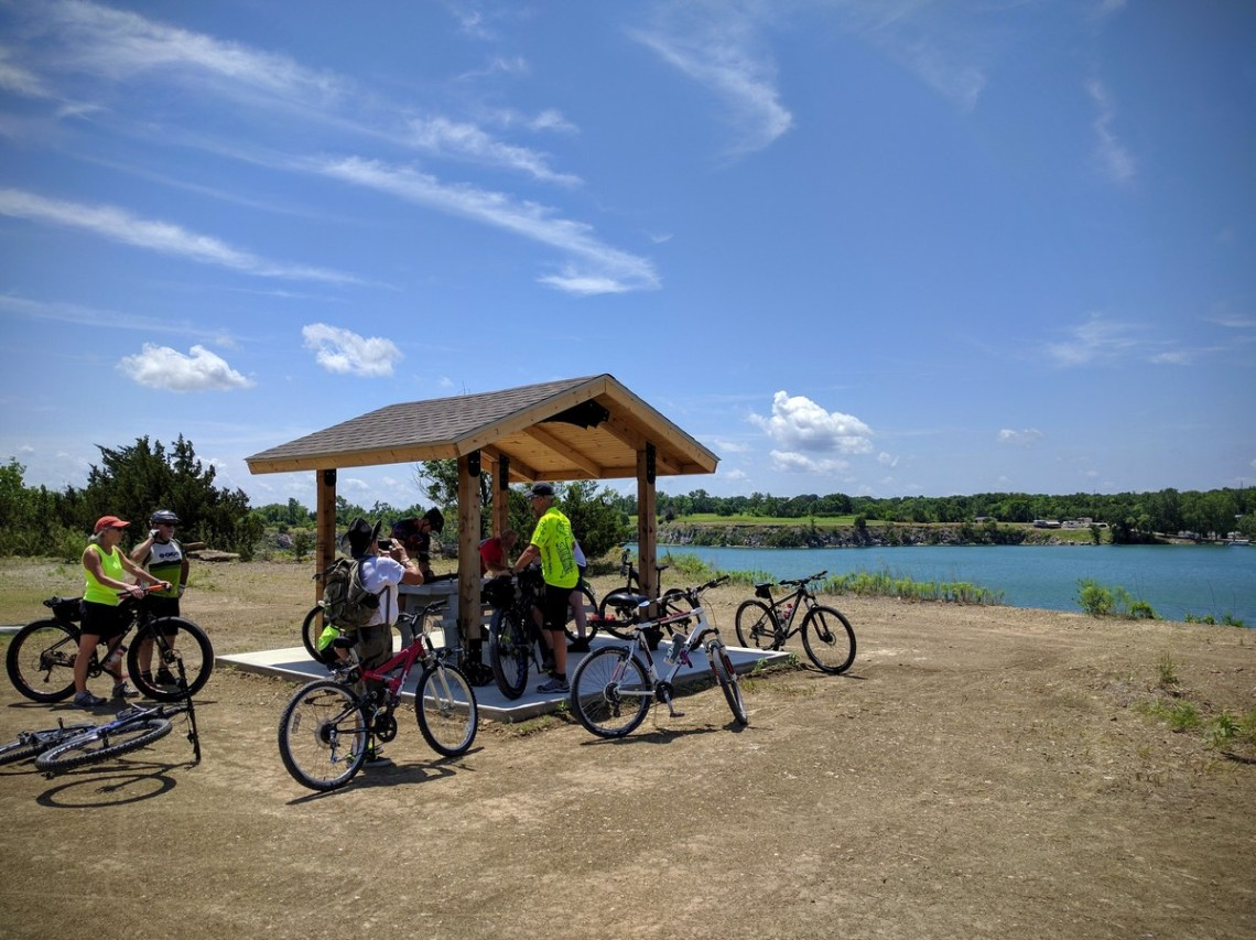 Riders gather at the shelter house on the bluffs over the quarry lake.