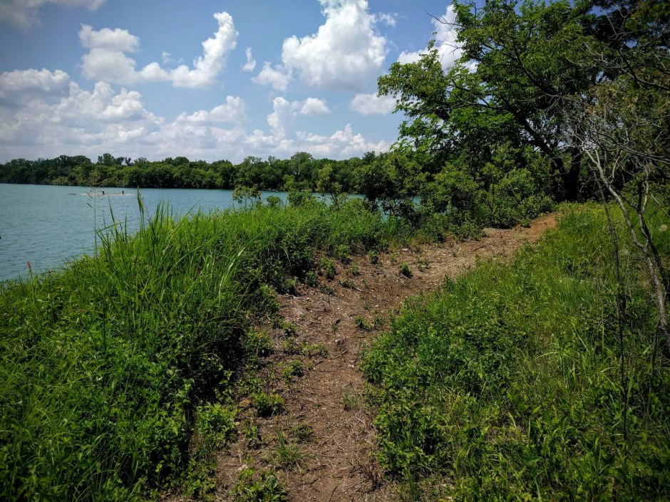 The trail opens up a number of times to provide expansive views of the lake. Pause to take it in, or rail that bermed turn.