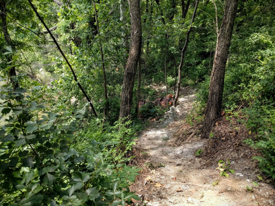 Towards the western end of the Mountain Goats Trail, the route passed through an area that had been used as a dumping ground for many years. Work on your bike-handling skills as you weave between the trees and dodge various types of debris and rubble.