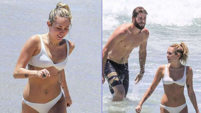 Miley Cyrus flaunts assets in a thong while vacationing with Liam Hemsworth
