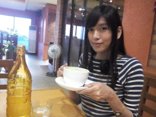 Le me holding a cup of green tea matcha!! <3