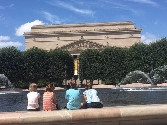 Girls with their travel buddies at The Sculpture Garden, Wash DC