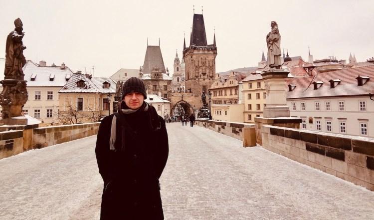 Crossing Charles Bridge Prague.