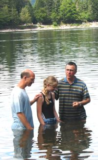 Rachel baptized by Pastor Luc and an elder of our church here