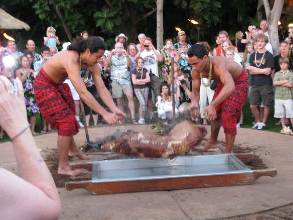 12/22 - Hale Koa luauBringing the pig out of the ground