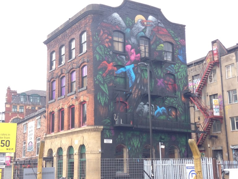 Urban art on a Manchester building facade on Port Street. Art by Mateus Bailon. Photo: Ana Ribeiro