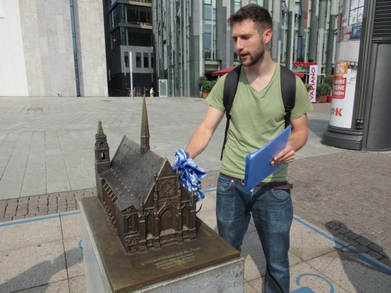 Matej tells us about the church that used to be where the uni is at Augustusplatz, Leipzig. (Photo: Ana Ribeiro)