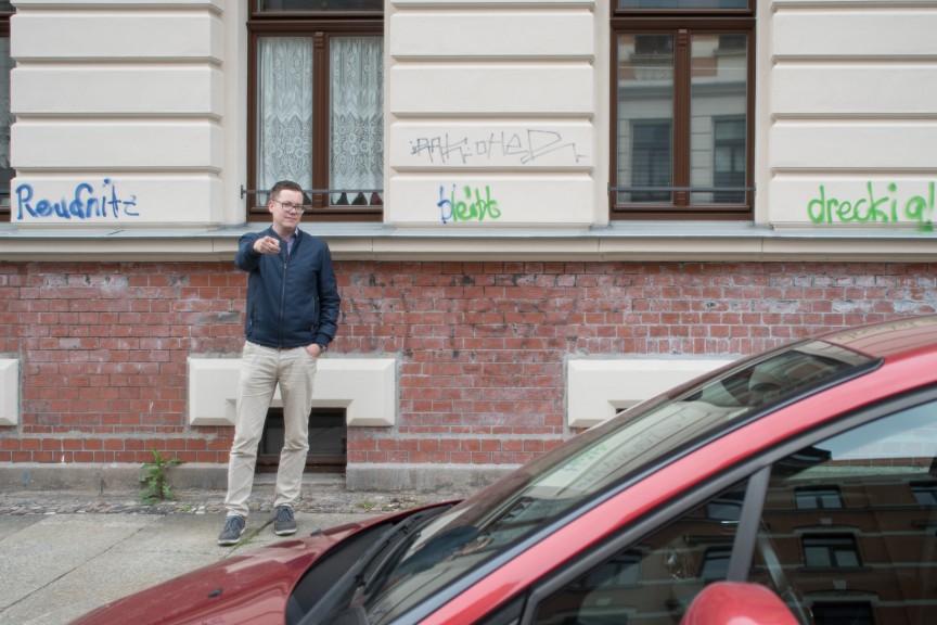 "Martin Meißner pauses in front of some graffiti saying ""Reudnitz stays dirty!"" (Photo: Stefan Hopf)"