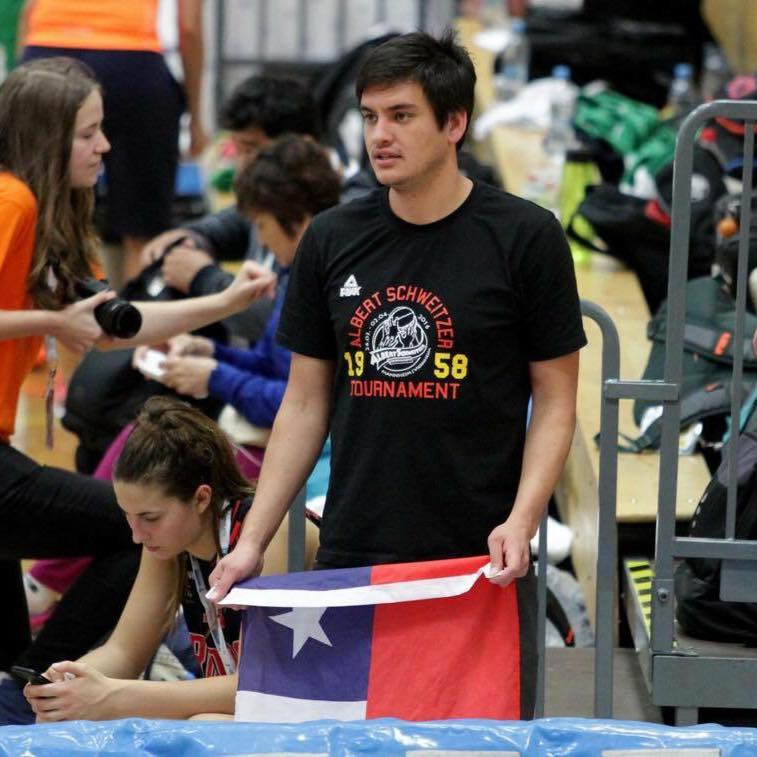 Sebastián Campos watches a young female player he trained in Chile play in a school-level world championship in Estonia. (Photo: Juan Pablo Perez Guerra)