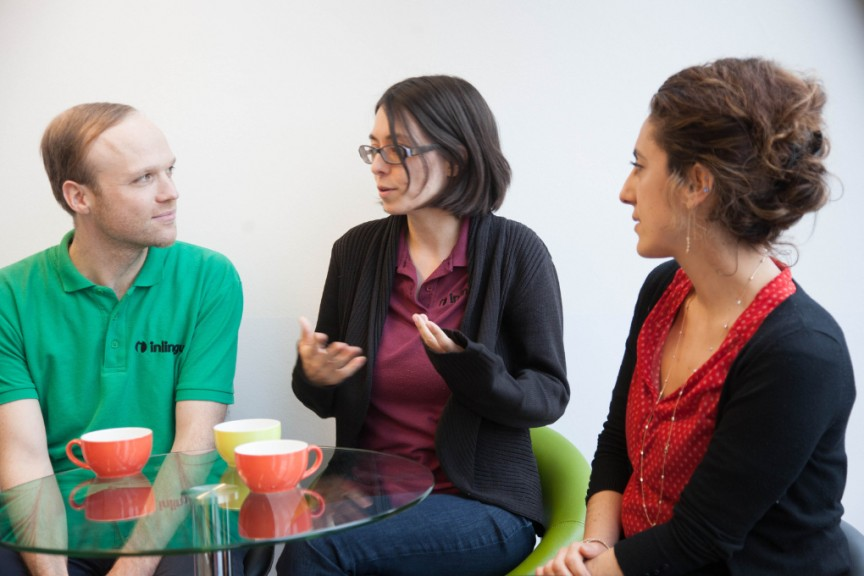 inlingua Director of German Studies Max Hündorf, Director of Studies Andréanne Roy, and School Director Carina Duteloff chatting in the language school's cafeteria. (Photo: maeshelle west-davies)