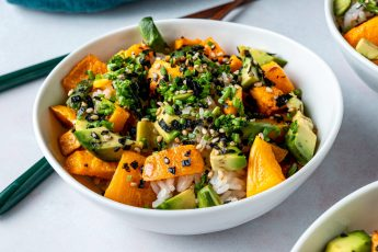 Close up of butternut squash and avocado rice bowl.