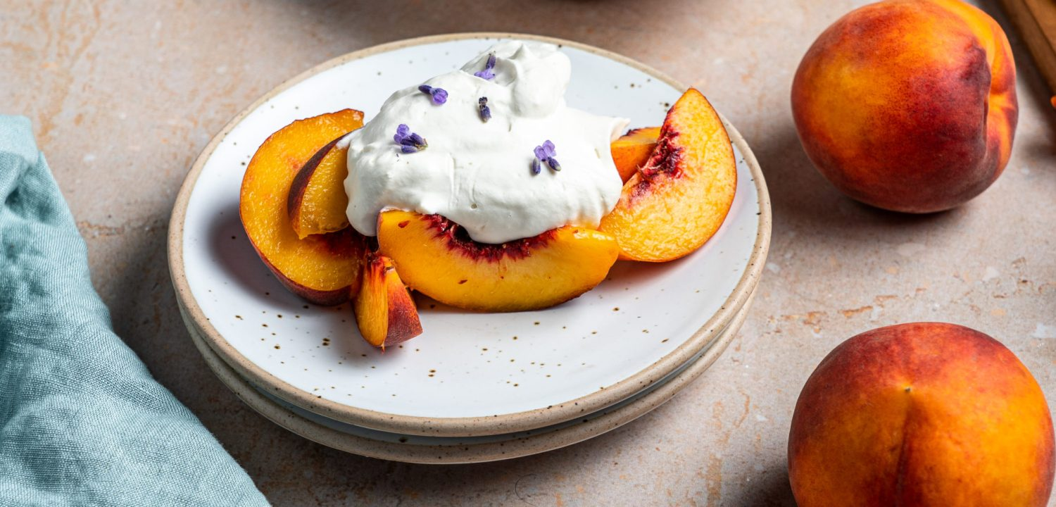 A heaping plate of peaches and lavender whipped cream.