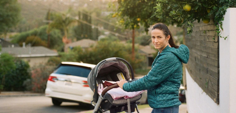 Woman walking baby in Uppababy Vista Stroller